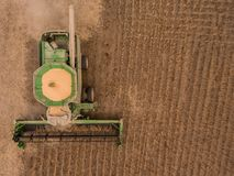 Aerial of a combine harvesting soybeans Royalty Free Stock Photos