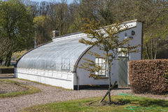 The large green house. A large green house with curved glass side Stock Images
