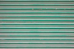 Large green metallic tin stripy fence background Royalty Free Stock Photography