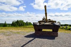A large green military metal armored deadly dangerous iron Russian Syrian battle tank with a gun turret and a goose royalty free stock photo