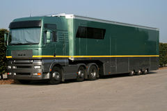 Large green support truck. In car park stock photos