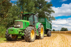 Large green tractor with trailer Stock Photography