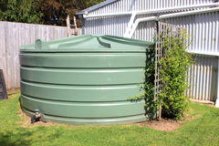 Large green water tank Stock Photo
