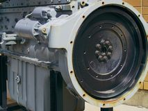 Large grey and black industrial engine. With large wheel, block, and oil pan showing Royalty Free Stock Photo