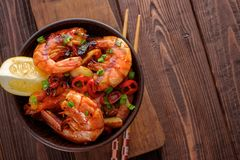 Large grilled BBQ shrimp with sweet chili sauce, green onion and. Lemon, copyspace stock photos