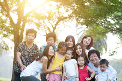 Large group of Asian multi generations family outdoors fun Stock Image