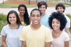 Large group of beautiful young men and women from all over the w royalty free stock image
