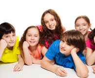 Boys and girls together on the floor Royalty Free Stock Photography