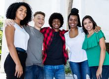 Large group of brazilian young adults arm in arm stock photo