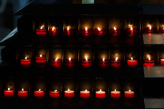 Large group of burning candles at a black background in the chur Royalty Free Stock Photos