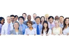 Large Group of Business People Holding Board.  Stock Photography