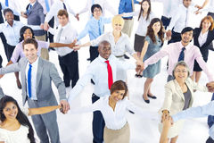 Large Group of Business People Holding Hands Royalty Free Stock Images