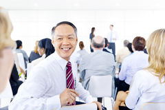 Large group of business people in presentation Stock Images