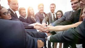Large group of business people standing with folded hands togeth. Concept of team building. large group of business people standing with folded hands together Stock Image