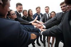 Large group of business people standing with folded hands together Stock Images