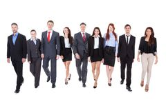 Large group of business people walking. Towards camera. Isolated on white Stock Photography