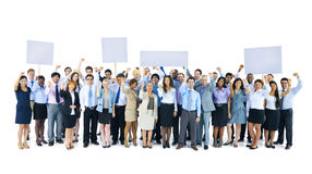 Large Group of Business Team Holding Board Stock Images