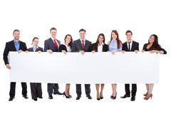 Large group of businesspeople presenting banner Royalty Free Stock Photos