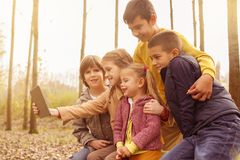 Portrait of four children in the park. stock images