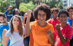 Large group of cheering young adults stock images