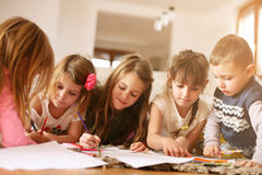 Large group of children lying on the floor. royalty free stock photos