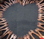 Large Group of Children's Hand Forming a heart shape. A large group of children's hands coming together on pavement to form the shape of a heart.  Shot from Royalty Free Stock Photography