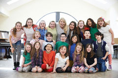 Large Group Of Children With Teacher Enjoying Drama Workshop Tog. Group Of Children With Teacher Enjoying Drama Workshop Together stock photos