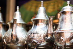 Large group, collection, of silver platted arabic mint tea pots. Close up horizontal composition Stock Photography