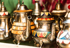 Large group, collection, of silver platted arabic mint tea pots. Close up horizontal composition Stock Images