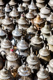 Large group, collection, of silver platted arabic mint tea pots. Close up vertical composition Stock Image