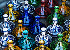 Large group of a colorful ceramic candlesticks. Royalty Free Stock Photos