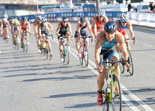 Large group of colorful triathletes cycling Royalty Free Stock Photos