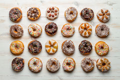 Large group of colorfully decorated donuts Stock Photo