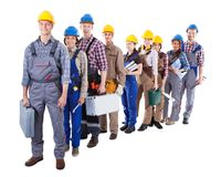 Large group of construction workers queuing up Stock Image