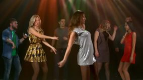 Large group on the dance floor in club. Girl stock footage