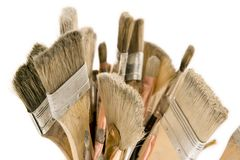 Isolated Used Paint Brushes. A large group of different sizes of paintbrushes isolated on white background Stock Images