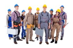 Large group of diverse workers. Large group of diverse workmen and women standing isolated on white