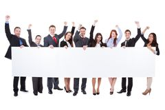 Large group of excited businesspeople presenting banner Royalty Free Stock Image