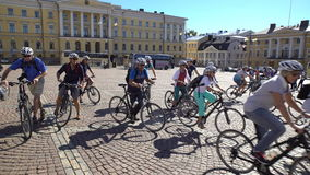 A large group of German tourists goes to bike ride around Helsinki. HELSINKI, FINLAND - AUGUST 31, 2016: A large group of German tourists goes to bike ride stock footage