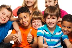 Large group of happy kids. Large group of diversity happy kids boys and girls of age 8-11 years old with one of them thumbs up and smile Stock Photos