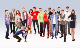 Large group of happy multicolored dressed teenagers Stock Photography