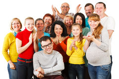 Large Group of Happy People standing together. Portrait of a large group of a Mixed Age people smiling and embracing together with Disabled Man Royalty Free Stock Photos
