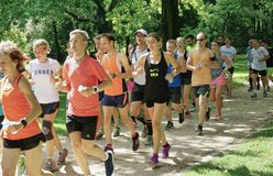 Large Group of Joggers in the Tiergarten Park in Berlin stock photos