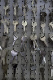 Large group of keys hanging on hooks in store Royalty Free Stock Photos