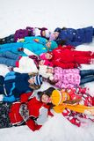 Large group of kids laying in snow Stock Photo