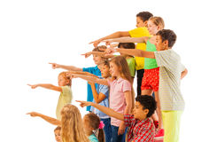 Large group of kids point fingers Royalty Free Stock Photo