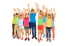 Large group of kids rise hands full height shoot Stock Photos
