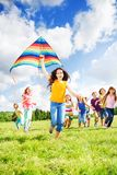 Large group of kids running royalty free stock photo