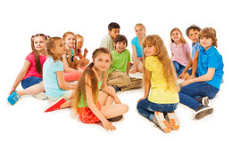 Large group of kids sit together in circle Stock Photography