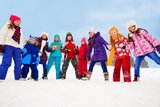 Large group of kids together on snow day Stock Photos